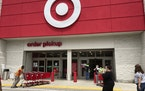 Customers arrive at a Target store, Wednesday, June 2, 2021, in North Miami Beach, Fla. Target says Thursday, Sept. 23, it will hire fewer seasonal wo