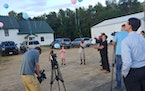 Peace activist KG Wilson, wearing hat, released balloons last week near the spot where four people were found slain. Damone Presley Sr., the father of