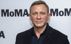 James Bond star Daniel Craig has been made an honorary commander in the service — the same rank held by the fictional secret agent.