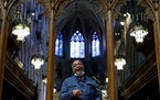 Artist Kerry James Marshall speaks at a news conference after being selected to design a replacement of former Confederate-themed stained glass window
