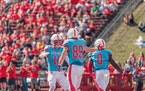 St. John's wide receiver Jimmy Buck (11) celebrates with tight end Alec Ganz (89) following Ganz's 57-yard touchdown reception in the Johnnies'