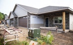 Construction continued on townhouses on the corner of Haines Rd. and Morris Thomas Rd. in Hermantown on Aug. 20. Duluth-area housing prices continued