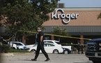 Police respond to the scene of a shooting at a Kroger's grocery store in Collierville, Tenn., on Thursday, Sept. 23, 2021.