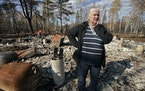 On her first visit to the site since the fire, Sandy Signorelli stood quietly among the ash that was the family cabin on Middle McDougal Lake.