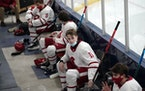 Benilde-St. Margaret's players rested in a makeshift locker room area with social distancing in the arena last January.