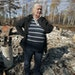 Sandy Signorelli of Duluth stood among the wreckage that was the family cabin on Middle McDougal Lake near Isabella, Minn., on Wednesday.