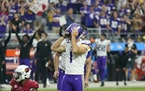 Minnesota Vikings kicker Greg Joseph (1) reacts to missing a game-winning field goal attempt against the Arizona Cardinals during the second half of a