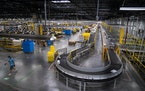 Shown is Amazon's larger fulfillment center in Shakopee. The Brooklyn Center warehouse, though, smaller will rely on automation to help workers as t