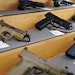 Handguns for sale sat behind glass in cases at the Stock & Barrel Gun Club Sept. 2, 2020.