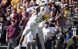 Minnesota wide receiver Chris Autman-Bell, left, pulls in a pass as Colorado safety Chris Miller defended last weekend.