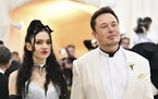 Grimes and Elon Musk attend the Metropolitan Museum of Art's Costume Institute benefit gala in New York on May 7, 2018.