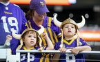 Young Minnesota Vikings fans donned Viking helmets and watched warmups before a preseason game last month.