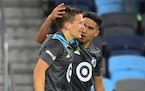 Loons midfielder Emanuel Reynoso (10) celebrated with midfielder Robin Lod (17) after Lod's game-winning goal May 15 against FC Dallas.