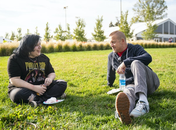 Mike Findley and his mentor, Christopher Cary, chatted during a Queerspace Collective meeting at the Minneapolis Sculpture Garden.