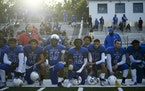 Minneapolis North players kneeled for the National Athem before their game against the SMB Wolfpack on Friday night.