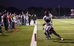 Maple Grove High School's Micha Vayee scored a touchdown in the first quarter.