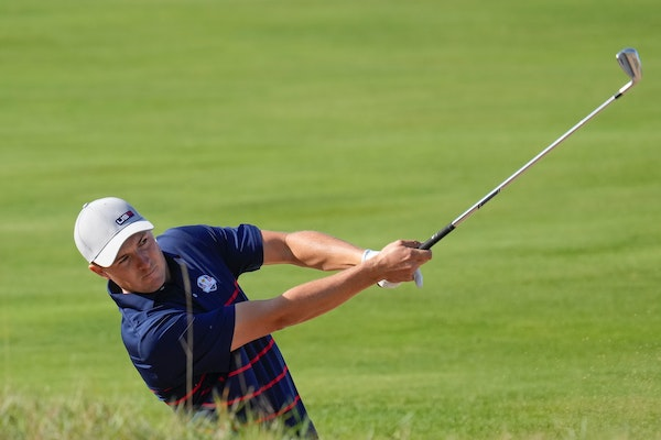Team USA's Jordan Spieth hits a shot on the 11th hole during a foursome match at the Ryder Cup
