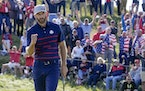 Team USA's Dustin Johnson reacts after winning the 11th hole during a four-ball match at the Ryder Cup