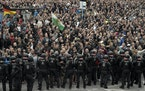 In this Monday, Aug. 27, 2018 file photo, demonstrators shout during a far-right protest in Chemnitz, Germany, after a man died and two others were in