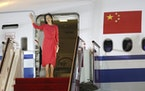 Huawei CFO Meng Wanzhou waves as she steps out of an airplane after arriving at Shenzhen Bao'an International Airport in Shenzhen in southern China�