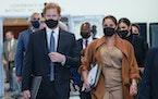 Prince Harry and Meghan, the Duke and Duchess of Sussex are escorted as they leave the United Nations headquarters after a visit during 76th session o