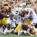 Minnesota Gophers quarterback Tanner Morgan (2) was tackled by a host of Bowling Green Falcons defenders during a rush in the second quarter.