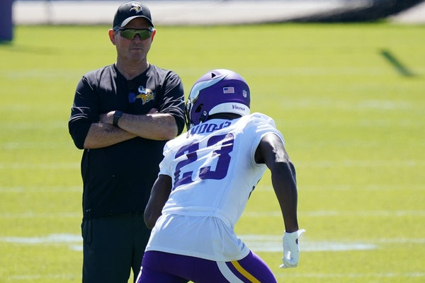 Mike Zimmer loves coaching defensive backs, such as safety Xavier Woods, and he needs to be at his best with this group now.