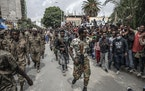 Captured Ethiopian government soldiers are marched under guard by Tigray Defense Force fighters through the city of Mekelle, Ethiopia on June, 25, 202
