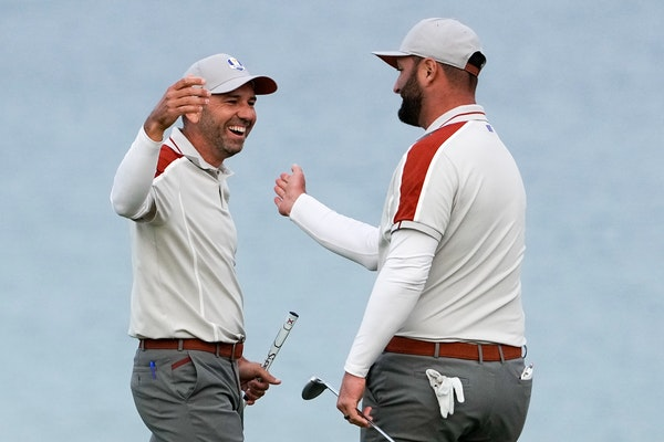 Team Europe's Sergio Garcia and Jon Rahm celebrate on the 16th hole during a four-ball match the Ryder Cup