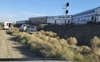In this photo provided by Kimberly Fossen an ambulance is parked at the scene of an Amtrak train derailment on Saturday, Sept. 25, 2021, in north-cent