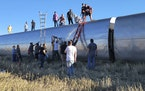 In this photo provided by Kimberly Fossen people work at the scene of an Amtrak train derailment on Saturday, Sept. 25, 2021, in north-central Montana