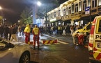 An ambulance takes care of the injured as Norway reopens from the coronavirus restrictions in Trondheim, Norway, Saturday, Sept. 25, 2021. The governm
