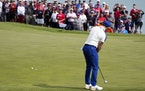 Team Europe's Rory McIlroy putts on the second hole during a singles match the Ryder Cup at the Whistling Straits Golf Course Sunday, Sept. 26, 2021