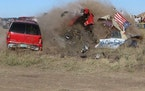Daredevil John Smith, known as the Flying Farmer, crashes his Chevrolet Caprice while attempting a jump on Saturday, Sept. 25, 2021 in Makoti, N.D. He