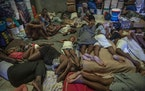 Internally displaced people due to violence sleep inside a school converted into a shelter in Port-au-Prince, Haiti, Thursday, Sept. 16, 2021. Deporte