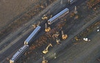 This aerial view taken Sunday shows part of an Amtrak train that derailed in north-central Montana on Saturday that killed at least three people and l