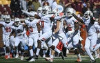 Bowling Green players celebrated a late fourth-quarter interception by safety Jordan Anderson (0), effectively clinching a 14-10 upset of the Gophers