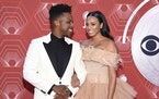 Leslie Odom Jr., left, and Nicolette Robinson arrive at the 74th annual Tony Awards at Winter Garden Theatre on Sunday, Sept. 26, 2021, in New York.