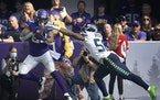 Minnesota Vikings tight end Tyler Conklin (83) caught a first quarter touchdown over Seattle Seahawks linebacker Jordyn Brooks (56).