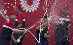 Team USA players sprayed champagne after winning the Ryder Cup on Sunday.