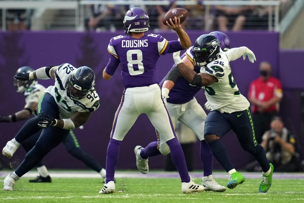 In raucous home opener, Cousins and Vikings dominate Seattle