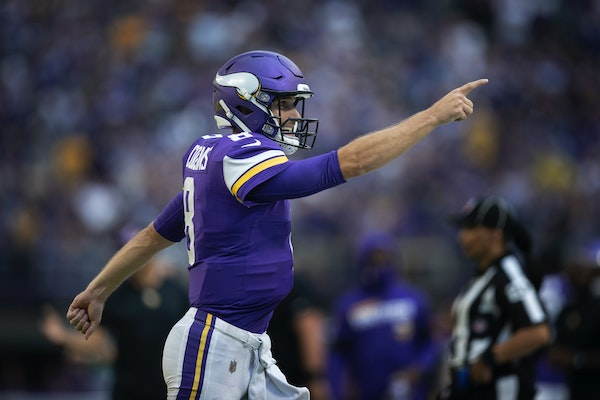 Kirk Cousins reacted after throwing a touchdown pass in the second quarter.