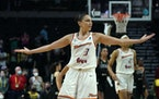 Phoenix Mercury's Diana Taurasi motions after a teammate scored in overtime against the Seattle Storm.