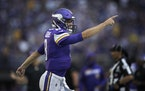 Minnesota Vikings quarterback Kirk Cousins (8) reacted after throwing a touchdown to Minnesota Vikings wide receiver Justin Jefferson (18) in the seco