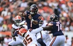 Chicago Bears quarterback Justin Fields (1) is hit by Chicago Bears defensive tackle Khyiris Tonga (95) after a pass during the second half.