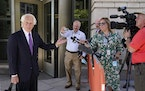 Barry Levine, left, attorney for John Hinckley Jr., speaks with reporters outside U.S. District Court, Monday, Sept. 27, 2021, in Washington, after a