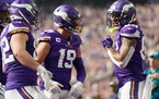 Vikings tight ends Ben Ellefson, left, and Tyler Conklin, right, celebrate Conklin's touchdown against Seattle with Adam Thielen.