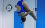 Gabby Mauder of Woodburywon the Woodbury Diving Invitational with an 11-dive score of 455.85, the state's best of the season.