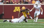Gophers wide receiver Chris Autman-Bell was tackled by Bowling Green safety Jordan Anderson in the first quarter Saturday. Autman-Bell soon afterward