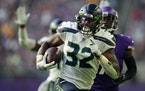 Seahawks running back Chris Carson had 10 carries for 74 yards and a touchdown in the first half against the Vikings on Sunday.